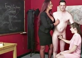 Fully clothes skanks give hairy dude a handjob