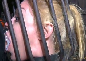 Busty blonde Darling trained for brutal deepthroat in headcage