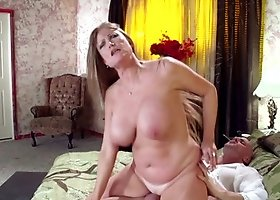 MILF deals with muscled bald fucker in her comfortable bedroom