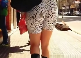 Big ass chick in black and white spandex shorts