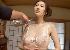 Japanese hottie oils her body and plays with the guy's hard dick