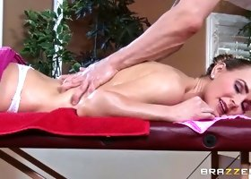 Perverted and muscular masseur rubs her pussy and her sexy titties