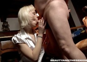 Slutty girl in a satin blouse blows a really old man