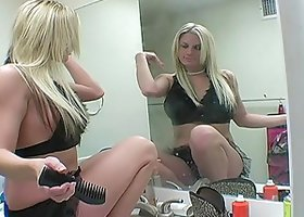 Hot blonde Melissa B wearing a miniskirt applies her make up