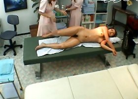 Naked and awesome japanese girl is having body massage
