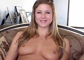 Lovely blonde sucks dildo on the sofa