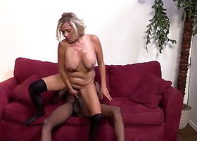 Nasturally busty blonde milf enjoys interracial rear pounding