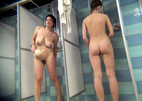 Hidden camera shows a hot brunette in the shower