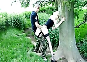 Banging skinny slut in a standing doggy position in the forest